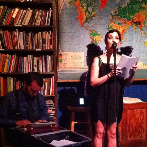The editor & the amazing Alibi Jones welcome the crowd. Photo by Trisha Siegelstein
